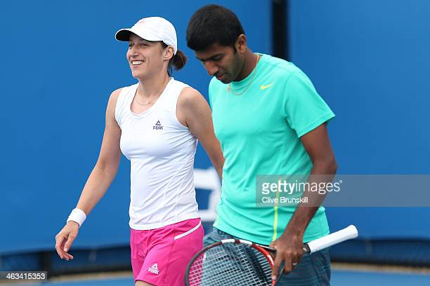 Katarina Srebotnik of Slovakia and Rohan Bopanna of India talk tactics in their first round mixed doubles match against Raquel KopsJones of the...