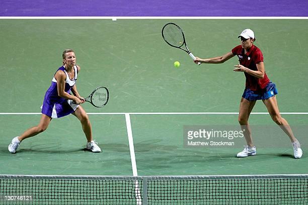 Katarina Srebotnik of Slovakia returns a shot to Vania King and Yaroslava Shvedova of Kazikstan while playing with Kveta Peschke of the Czech...