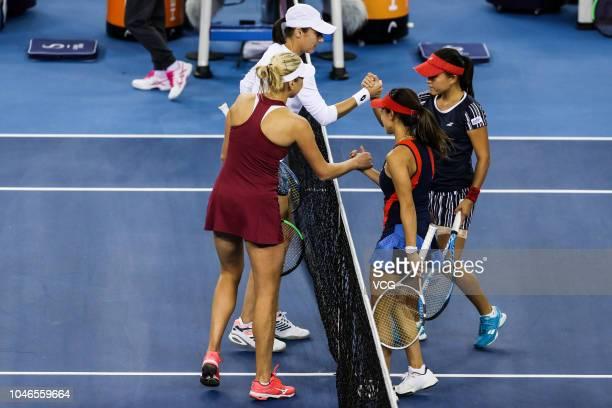 Katarina Srebotnik of Slovenia and Lyudmyla Kichenok of Ukraine shake hands with Makoto Ninomiya and Miyu Kato of Japan after their Women's Doubles...