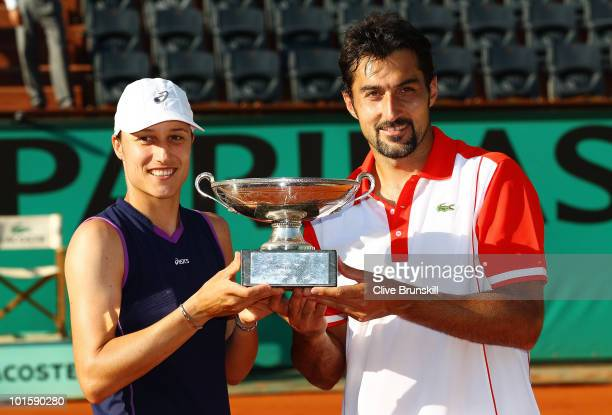 Katarina Srebotnik of Slovenia and Nenad Zimonjic of Serbia poses with the trophy after winning the mixed doubles final match between Katarina...