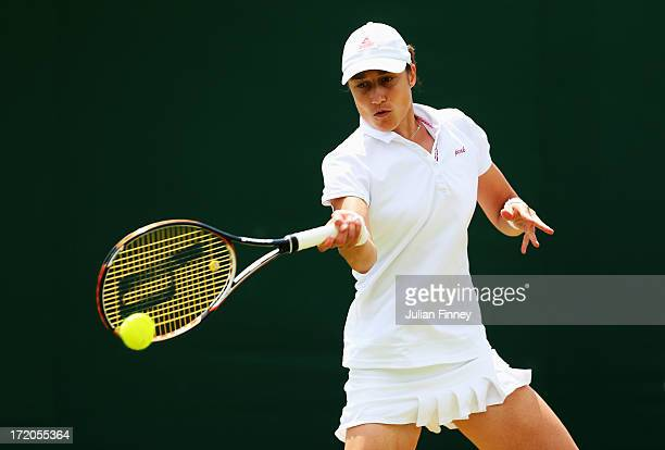 Katarina Srebotnik of Slovenia plays a forehand during the Ladies' Doubles third round match between Vania King of the United States of America and...
