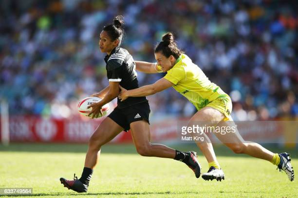 Katarina WhataSimpkins of New Zealand is tackled by Emilee Cherry of Australia during the womens bronze final match between Australia and New Zealand...