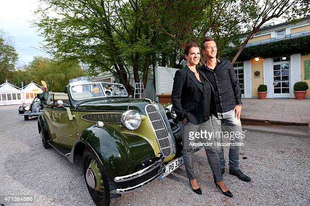 Katarina Witt arrives with Philipp Kohlschreiber in a historical BMW car for the Iphitos Tennis Club 100 years celebration at Iphitos Tennis Club...