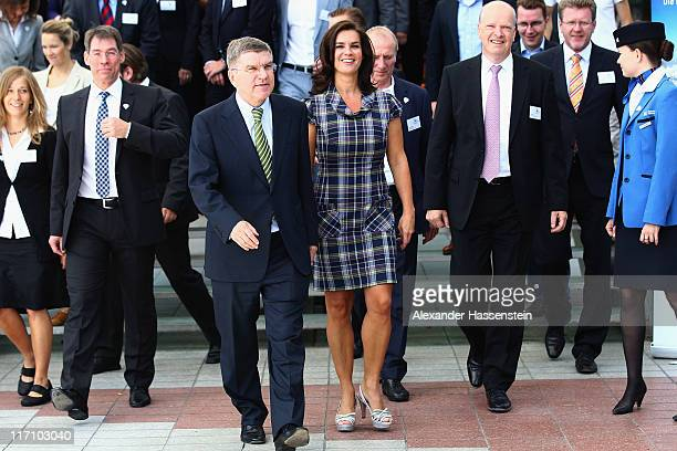 Katarina Witt Chair of Munich 2018 arrives with IOC Vice President and Chairman of the Munich 2018 Shareholder Board Thomas Bach for the Munich 2018...