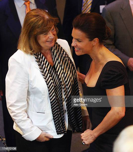 Katarina Witt Chair of Munich 2018 chats with Gunilla Lindberg head of the IOC Evaluation Commission during the briefing for IOC members at the...