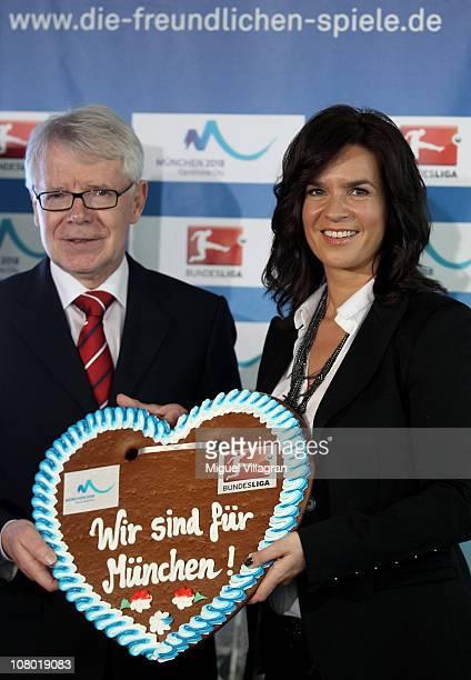 Katarina Witt Chair of the Munich 2018 Bid Commitee and Reinhard Rauball president of Deutsche Fussball Liga pose with a gingerbread heart with the...