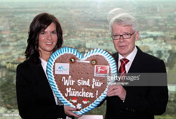 Katarina Witt , Chair of the Munich 2018 Bid Commitee and Reinhard Rauball, president of Deutsche Fussball Liga , pose with a gingerbread heart with...