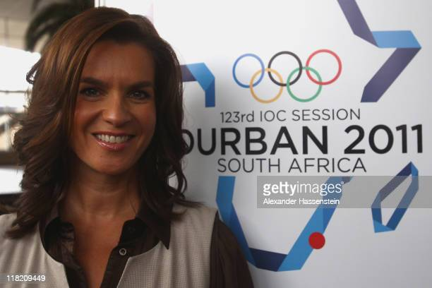 Katarina Witt Chair of the Munich 2018 Bid Committee and twotime Olympic champion poses during a photo call at the International Convention Center on...