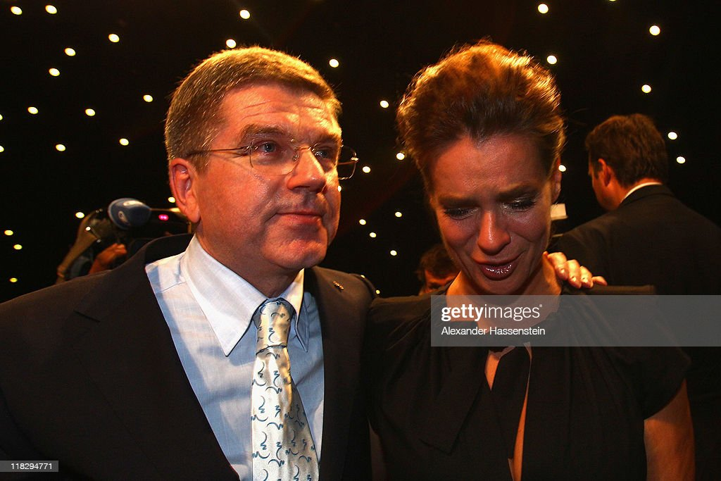 Katarina Witt, Chair of the Munich 2018 Bid Committee reacts with Thomas Bach, President of the German Olympic Sports Confederation (DOSB) and Olympic champion after the announcing of the host city for the 2018 Olympic Winter Games during the 123rd IOC session on July 6, 2011 in Durban, South Africa.