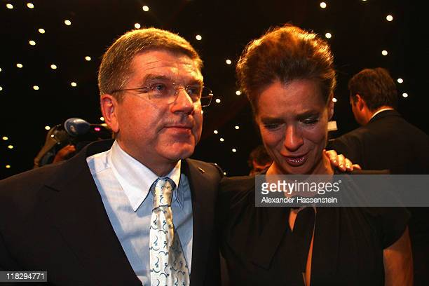 Katarina Witt Chair of the Munich 2018 Bid Committee reacts with Thomas Bach President of the German Olympic Sports Confederation and Olympic...