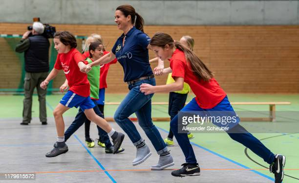 Katarina Witt is playing football with children of the Laureus project Kicking Girls as Berlin is announced as the host city for the Laureus World...