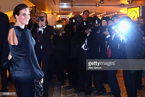 Katarina Witt is surrounded by photographers during the 31. Sportpresseball at Alte Oper on November 10, 2012 in Frankfurt am Main, Germany.