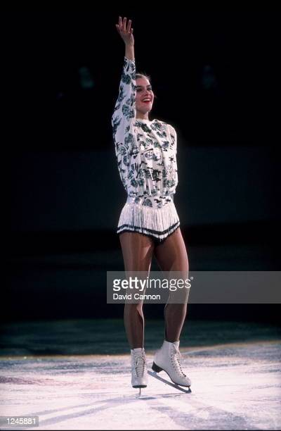 Katarina Witt of East Germany waves to the crowd as she completes her routine in the women's free skate exhibition following her gold medal...
