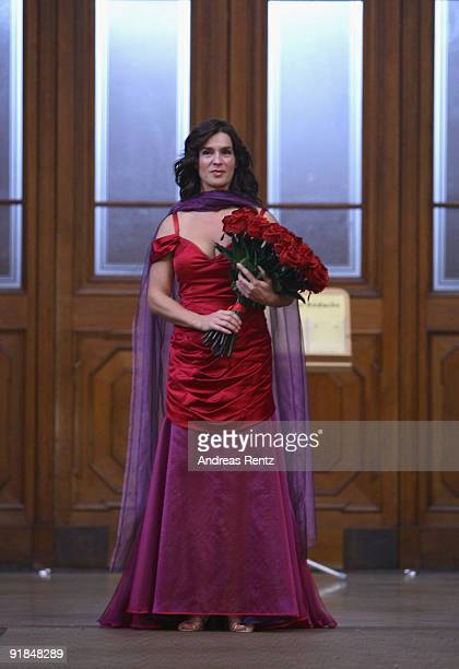Katarina Witt performs during the 'Jedermann' dress rehearsal at the Berlin Cathedral Church on October 13, 2009 in Berlin, Germany.