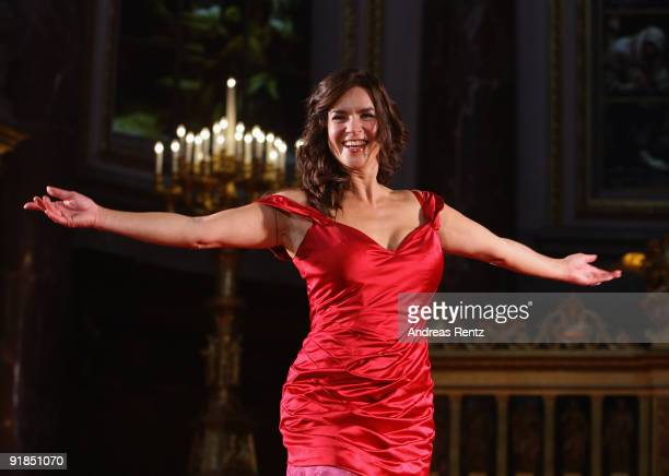 Katarina Witt performs on stage during the 'Jedermann' dress rehearsal at the Berlin Cathedral Church on October 13, 2009 in Berlin, Germany.