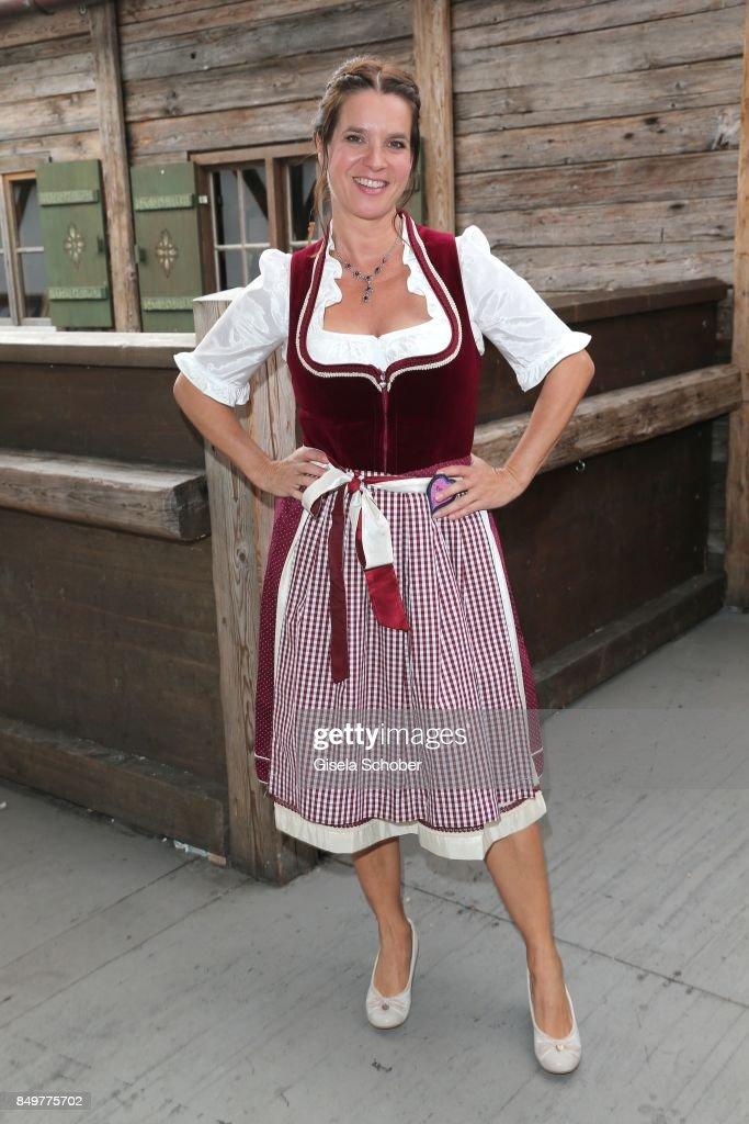 Katarina Witt, wearing a red dirndl by Angermaier