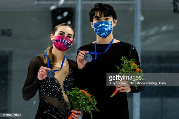 Katarina Wolfkostin and Jeffrey Chen of USA pose with the silver medal during medal ceremony after the ISU Junior Grand Prix of Figure Skating at...