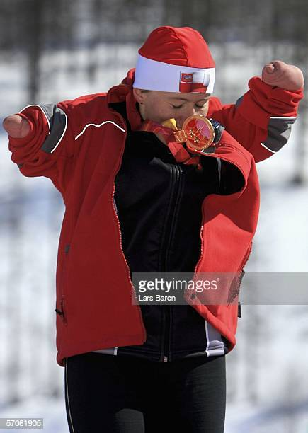 Katarzyna Rogowiec of Poland celebrates winning gold in the Women's 5KM Standing Cross Country during day two of the Turin 2006 Winter Paralympic...