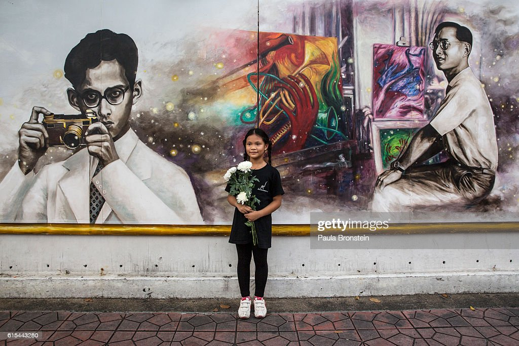 Katchaporn Krampan,age 8, poses by a series of paintings created in memory of the late King of Thailand near the Royal palace on October 18, 2016 in Bangkok, Thailand. Thailand's King Bhumibol Adulyadej, the world's longest-reigning monarch, died at the age of 88 in Bangkok's Siriraj Hospital on Thursday after his 70-year reign. The Crown Prince Maha Vajiralongkorn had asked for time to grieve the loss of his father before becoming the next king as nation waits for the coronation date.