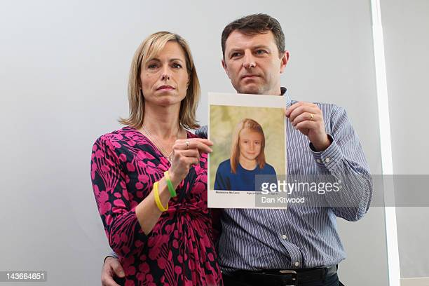 Kate and Gerry McCann hold an ageprogressed police image of their daughter during a news conference to mark the 5th anniversary of the disappearance...