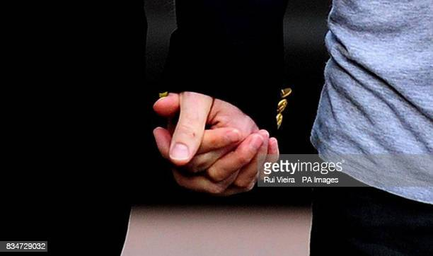 Kate and Gerry McCann holds hands as they arrive to give a statement at the Rothley Court Hotel in Rothley Leicestershire after they were formally...