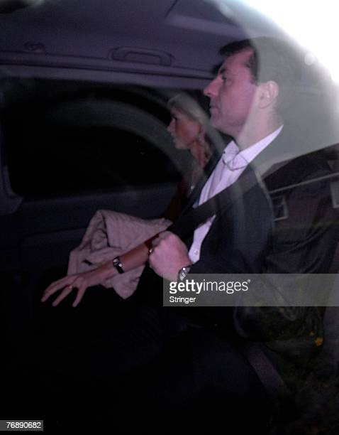 Kate and Gerry McCann leave their home in a blacked out taxi believed to be heading for London to meet their lawyers on 20 September Rothley England...