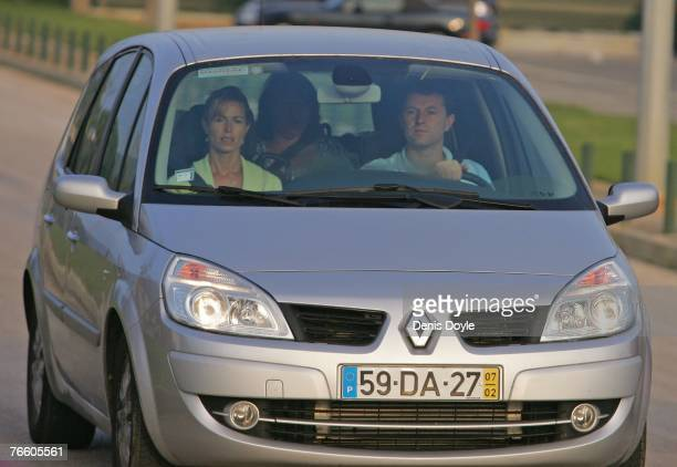Kate and Gerry McCann the parents of missing fouryearold Madeleine McCann arrive at Faro airport by car to board an Easyjet plane back to England on...