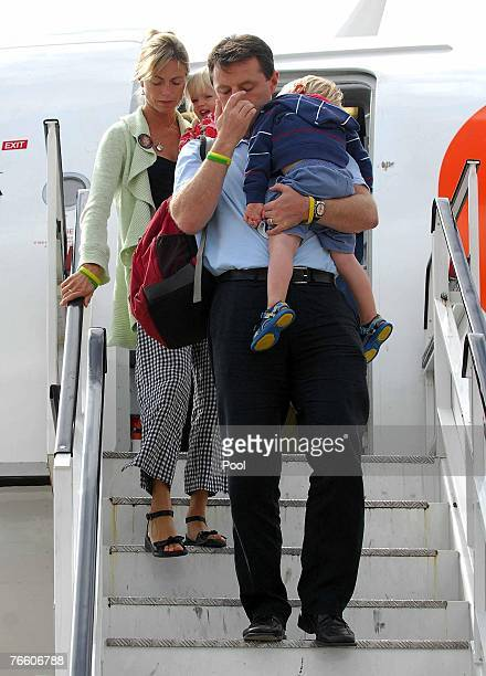 Kate and Gerry McCann the parents of missing fouryearold Madeleine McCann arrive back in the UK to East Midlands airport after taking a flight from...