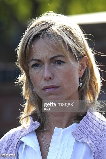 Kate and Gerry McCann walk outside their house as new spokesman Clarence Mitchell a former BBC journalist gives a statement to the press September 18...