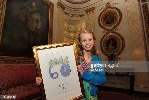 Kate Armistead from Devizes in Wiltshire, waits to show Queen Elizabeth II her winning design for an an emblem for the Queen's Diamond Jubilee, in a...