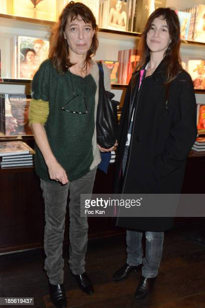 Kate Barry and Charlotte Gainsbourg attend the 'Jane Et Serge A Family Album' Book Signing At Taschen Odeon on October 22 2013 in Paris France
