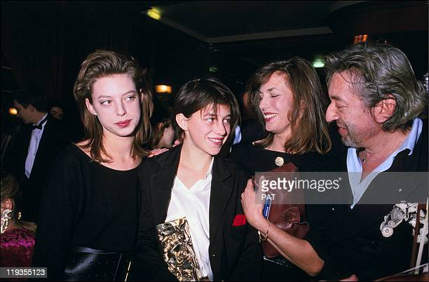 Kate Barry Charlotte Gainsbourg and parents Jane Birkin and Serge Gainsbourg at the the 11st Cesar Award Ceremony on February 27 1986 in Paris France...