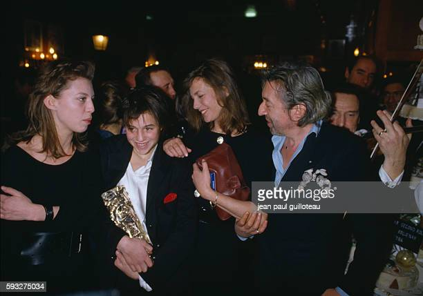 Kate Barry Charlotte Gainsbourg Jane Birkin and Serge Gainsbourg at Fouquets after the César award ceremony during which Charlotte won an award for...