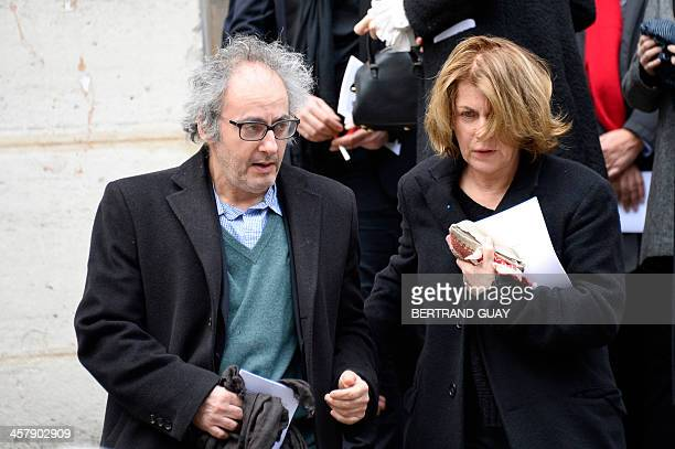 Kate Barry's partner French actor and producer Oury Milshtein and an unidentified person leaves the funeral of former British photographer Kate Barry...