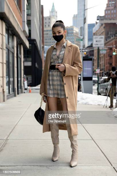 Kate Bartlett poses outside New York Fashion Week at Spring Studios on February 16, 2021 in New York City.