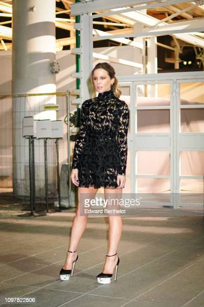 Kate Beckinsale a black mesh lace dress wears outside Giambattista Valli during Paris Fashion Week Haute Couture Spring Summer 2020 on January 21...
