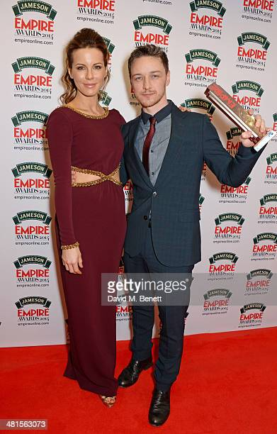 Kate Beckinsale and James McAvoy winner of the Jameson Best Actor award for 'Filth' poses in the press room at the Jameson Empire Awards 2014 at The...