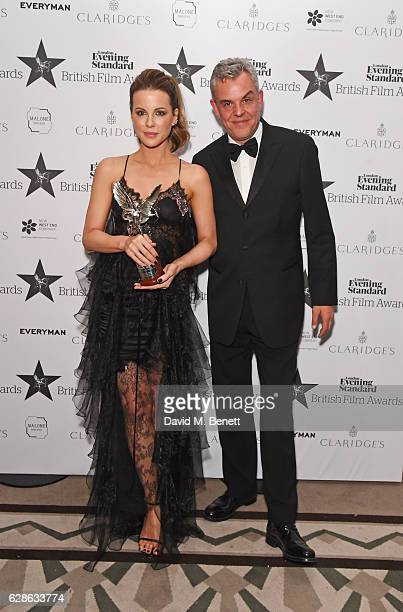 Kate Beckinsale winner of the Best Actress award for Love Friendship and presenter Danny Huston pose at The London Evening Standard British Film...