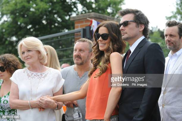 Kate Beckinsale with mother Judy Loe and husband Len Wiseman watched by Michael Sheen during a visit to College House Junior School where the...
