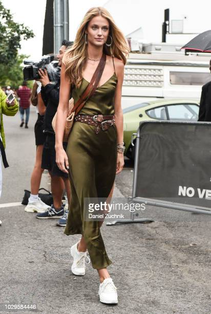 Kate Bock is seen wearing a green slip dress outside the Brandon Maxwell show during New York Fashion Week Women's S/S 2019 on September 8 2018 in...