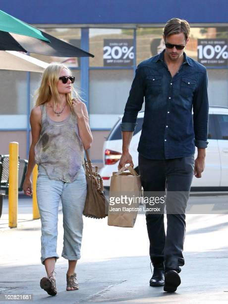 Kate Bosworth and Alexander Skarsgard shop at Bristol Farms in West Hollywood on July 11 2010 in Los Angeles California