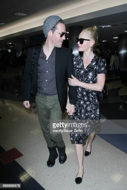 Kate Bosworth and Michael Polish are seen at LAX on June 16 2017 in Los Angeles California
