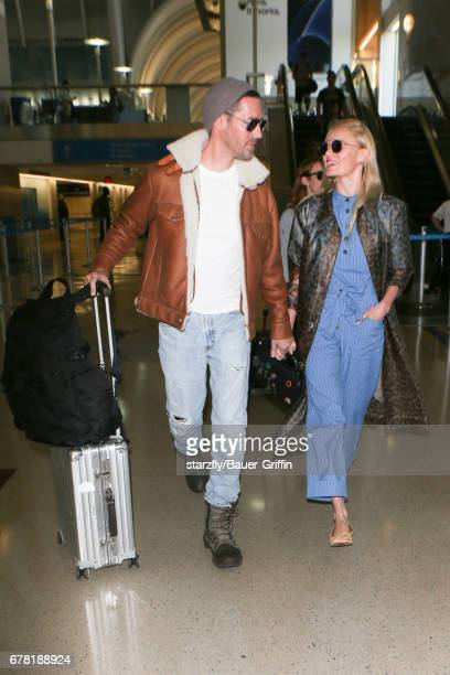 Kate Bosworth and Michael Polish are seen at LAX on May 03 2017 in Los Angeles California
