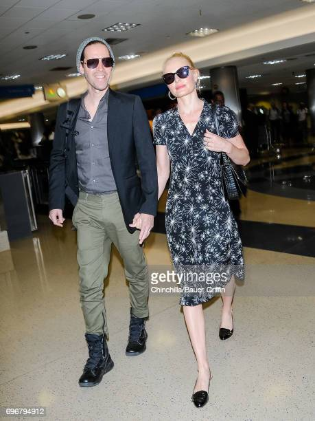 Kate Bosworth and Michael Polish are seen at Los Angeles International Airport on June 16 2017 in Los Angeles California