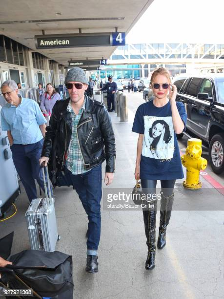 Kate Bosworth and Michael Polish are seen at Los Angeles International Airport on March 05 2018 in Los Angeles California