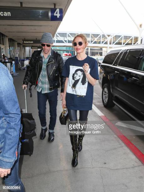 Kate Bosworth and Michael Polish are seen at 'Los Angeles International Airport' on March 05 2018 in Los Angeles California