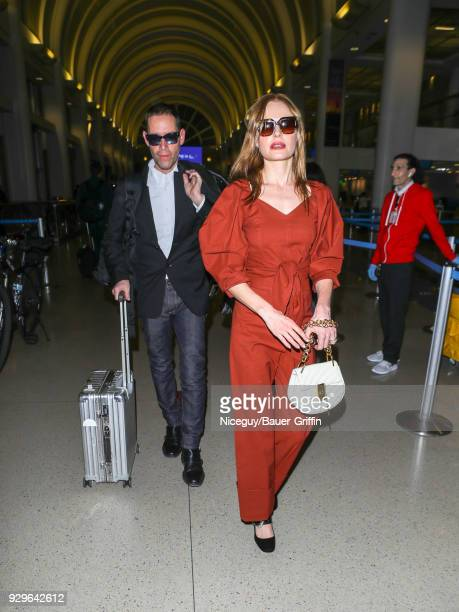Kate Bosworth and Michael Polish are seen at Los Angeles International Airport on March 08 2018 in Los Angeles California