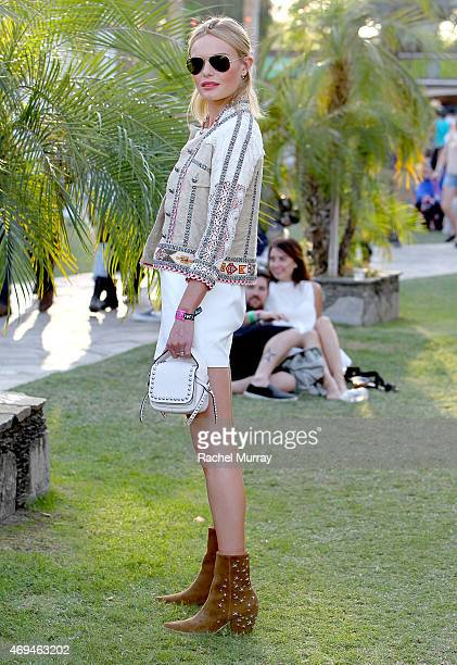 Kate Bosworth wearing a Coach handbag and boots she designed for her Matisse shoe line attends the 2015 Coachella Valley Music and Arts Festival...