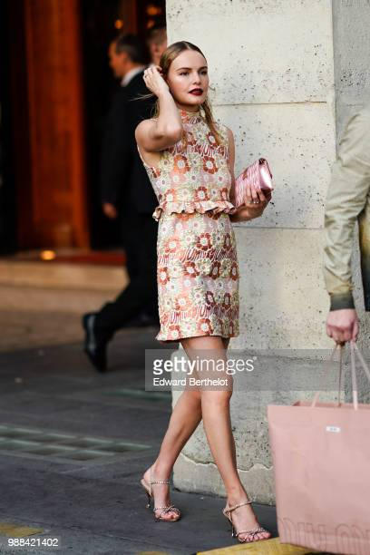 Kate Bosworth wears a floral print dress and a pink bag from Miu Miu, outside the Miu Miu Cruise Collection show, outside the Hotel Regina, in Paris,...