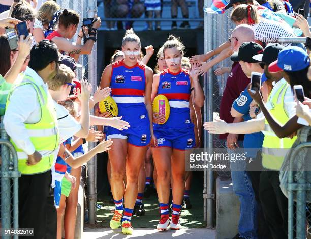 Kate Brennan and Ellie Blackburn of the Bulldogs lead the team out during the round one AFLW match between the Western Bulldogs and the Fremantle...